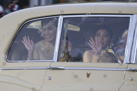 Thai Queen Suthida (L), Thai King Maha Vajiralongkorn Bodindradebayavarangkun (C, back) and Thai Princess Sirivannavari Nariratana (R) wave at well-wishers as the Royal motorcade carrying the Thai Royal family arrives before the start of a ceremony in remembrance of late Thai King Bhumibol Adulyadej's birthday anniversary and also marking the National Father's Day, at Sanam Luang ceremonial ground in Bangkok, Thailand, 05 December 2020. King Bhumibol died at the age of 88 on 13 October 2016 after 70 years on the throne.