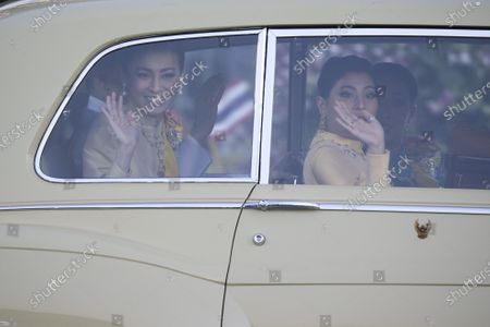 Thai Queen Suthida (L), Thai King Maha Vajiralongkorn Bodindradebayavarangkun (L,back) and Thai Princess Sirivannavari Nariratana (R) wave at well-wishers as the Royal motorcade carrying the Thai Royal family arrives before the start of a ceremony in remembrance of late Thai King Bhumibol Adulyadej's birthday anniversary and also marking the National Father's Day, at Sanam Luang ceremonial ground in Bangkok, Thailand, 05 December 2020. King Bhumibol died at the age of 88 on 13 October 2016 after 70 years on the throne.