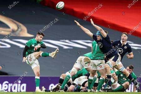 Ireland vs Scotland. Ireland's Conor Murray clears the ball despite Scott Cummings of Scotland