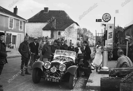 Bremgarten, Berne, Switzerland. 20 August 1939. The photographer stops to refuel his 2 5-litre Jaguar SS en route to the race, atmosphere. World Copyright: Robert Fellowes/LAT Photographic Ref: 39SUI04