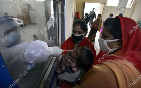A health worker collects sample for COVID-19 testing, at Swami Daya Nand Hospital, Dilshad Garden, on December 3, 2020 in New Delhi, India.
