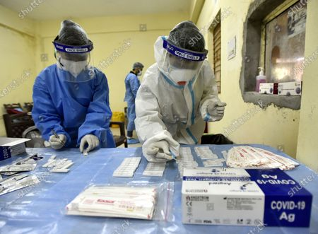 Health workers sort samples collected for COVID-19 test,  at Swami Daya Nand Hospital, Dilshad Garden, on December 3, 2020 in New Delhi, India.