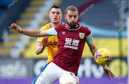 Burnley's Jay Rodriguez and Everton's Michael Keane challenge for the ball during the English Premier League soccer match between Burnley and Everton at Turf Moor in Burnley, north west England