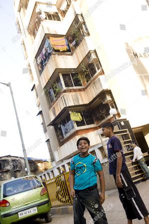 Azharuddin Mohammed Ismail with friends outside the new apartment in Santa Cruz, Mumbai that he shares with his family