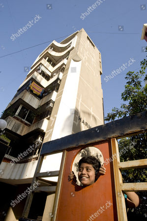 Azharuddin Mohammed Ismail outside of the new apartment in Santa Cruz, Mumbai that he shares with his family