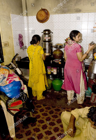Azharuddin Mohammed Ismail's sister and sister-in-law in the kitchen of the new apartment in Santa Cruz, Mumbai