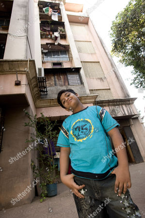 Azharuddin Mohammed Ismail outside the new apartment in Santa Cruz, Mumbai that he shares with his family