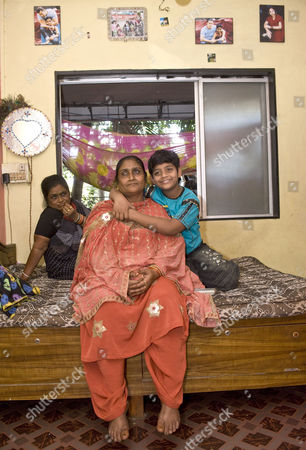 Azharuddin Mohammed Ismail with his mother and aunt inside their new apartment in Santa Cruz, Mumbai