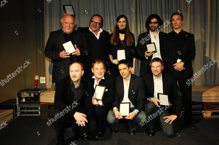 Stock Photo of Presenter Hannes Jaenicke (second row on the right) with the winners. First row, left to right: Peter Doerfler, Burghart Klaussner, Fabian Roemer, Hansjoerg Weissbrich Second row, standing left to right: Christian Berger, Stefan Arndt, unknown, Ali Samadi Ahadi