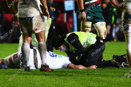 Tom Price of Exeter Chiefs is treated on the field during the Gallagher Premiership Rugby match between Leicester Tigers and Exeter Chiefs at Welford Road Stadium, Leicester