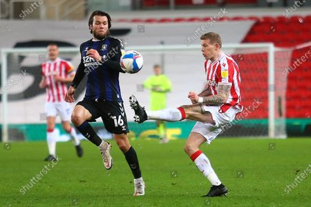 Stock Picture of Stoke City midfielder James McClean (11) and Middlesbrough midfielder Jonathan Howson (16) during the EFL Sky Bet Championship match between Stoke City and Middlesbrough at the Bet365 Stadium, Stoke-on-Trent