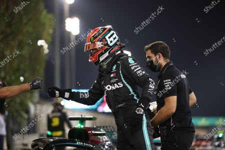 Mercedes driver George Russell of Britain, who earned the second best time, celebrates after the qualifying for the Bahrain Formula One Grand Prix, at the Formula One Bahrain International Circuit in Sakhir, Bahrain, . The Bahrain Formula One Grand Prix will take place on Sunday