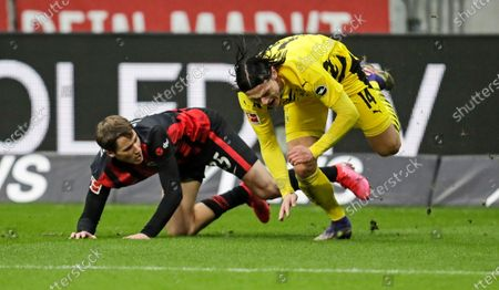 Frankfurt's Erik Durm, left, and Dortmund's Nico Schulz challenge for the ball during a German Bundesliga soccer match between Eintracht Frankfurt and Borussia Dortmund in Frankfurt, Germany