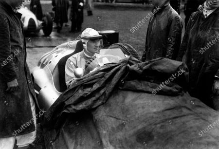 Spa-Francorchamps, Belgium. 26th June 1939. Dick Seaman, Mercedes-Benz W154, retired, on the grid before his fatal accident at La Source, portrait.  World Copyright: Robert Fellowes/LAT Photographic Ref: RF39_BEL_96.
