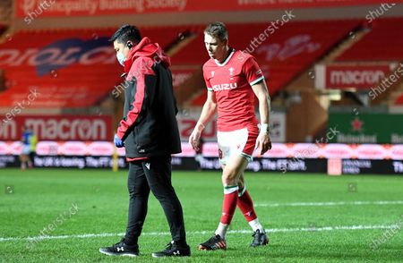 Liam Williams of Wales leaves the field with Prav Mathema.
