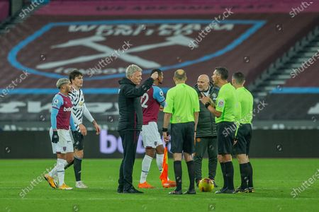 West Ham United Manager David Moyes talking to the Referee Andre Marriner  and linesmen at full time