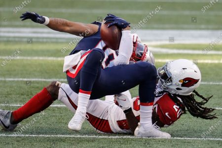 Arizona Cardinals cornerback Dre Kirkpatrick takes down New England Patriots wide receiver Damiere Byrd during an NFL football game at Gillette Stadium, in Foxborough, Mass