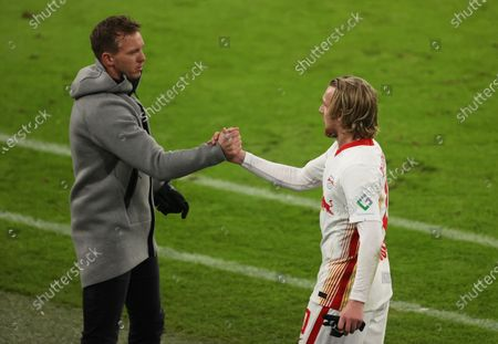 Emil Forsberg of RB Leipzig is greeted by coach Julian Nagelsmann as he is substituted off during the German Bundesliga soccer match between FC Bayern Munich and RB Leipzig at Allianz Arena in Munich, Germany, 05 December 2020.