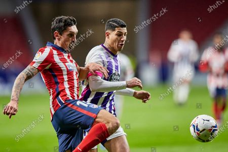 Stefan Savic of Atletico de Madrid and Marcos Andre of Real Valladolid