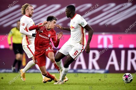 Bayern's Jamal Musiala (C) in action against Leipzig's Ibrahima Konate (R) and Emil Forsberg (L) during the German Bundesliga soccer match between FC Bayern Munich and RB Leipzig at Allianz Arena in Munich, Germany, 05 December 2020.