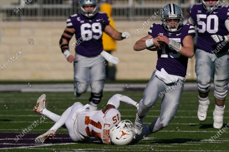 Kansas State quarterback Will Howard, right, is tackled by Texas defensive back Chris Brown, left, during the first half of an NCAA college football game in Manhattan, Kan