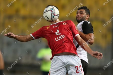 Stock Photo of Al-Ahly player Ali Maaloul (L) in action against Tala'ea El Gaish SC player Khaled Sotohi  during the Egypt Cup final soccer match between Al-Ahly and Tala'ea El Gaish SC at Borg Al Arab Stadium in Alexandria Egypt, 05 December 2020.