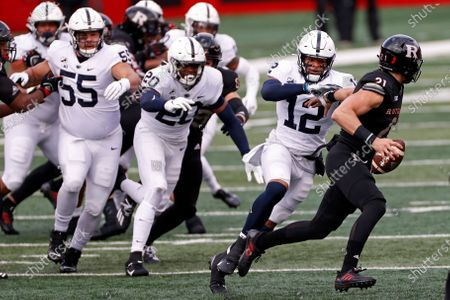 Penn State linebacker Brandon Smith (12) tackles Rutgers quarterback Johnny Langan (21) during the first half of an NCAA college football game, in Piscataway, N.J