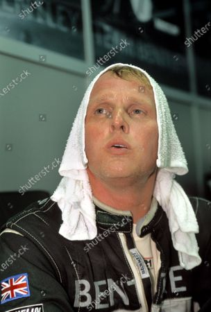 Le Mans, France. 14th - 15th June 2003. A tired Johnny Herbert after driving his night stint. World Copyright: Mike Weston/LAT Photographic. Ref:  03LM36.