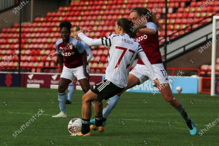 Tobin Heath (#77 Manchester United) battles with Sophie Haywood (#17 Aston Villa) during the FA Womens Super League 1 game between Aston Villa and Manchester United at Bescot Stadium in Walsall.