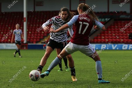 Sophie Haywood (#17 Aston Villa) battles with Tobin Heath (#77 Manchester United) during the FA Womens Super League 1 game between Aston Villa and Manchester United at Bescot Stadium in Walsall.