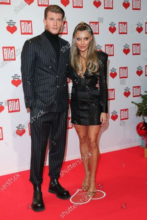 Sophia Thomalla and Loris Karius arrive for the 'Ein Herz Fuer Kinder' ('A Heart for Chidren') Gala at Studio Berlin Adlershof in Berlin, Germany, 05 December 2020. German television channel ZDF and newspaper 'Bild' collected donations for children's charity organizations in Germany and the whole world.