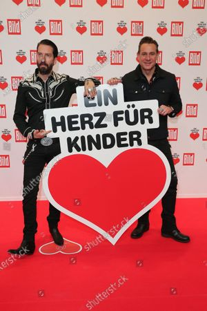 Stock Photo of Alec Voelkel (L) and Sascha Vollmer arrive for the 'Ein Herz Fuer Kinder' ('A Heart for Chidren') Gala at Studio Berlin Adlershof in Berlin, Germany, 05 December 2020. German television channel ZDF and newspaper 'Bild' collected donations for children's charity organizations in Germany and the whole world.