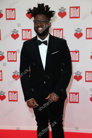 Stock Photo of Kelvin Jones arrives for the 'Ein Herz Fuer Kinder' ('A Heart for Chidren') Gala at Studio Berlin Adlershof in Berlin, Germany, 05 December 2020. German television channel ZDF and newspaper 'Bild' collected donations for children's charity organizations in Germany and the whole world.