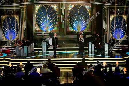 epa08865188 German singer Max Raabe (C-L) and Lea-Marie Becker (C-R) perform on stage during the 'Ein Herz Fuer Kinder' (lit: A Heart for Children) gala show in Berlin, Germany, 05 December 2020. German television channel ZDF and newspaper 'Bild' collected donations for children's charity organizations in Germany and the whole world. EPA-EFE/CLEMENS BILAN / POOL