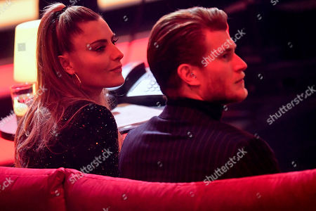 epa08865244 German actress, presenter and model, Sophia Thomalla (L), and German soccer goalkeeper Loris Karius (R), attend the 'Ein Herz Fuer Kinder' (lit: A Heart for Children) gala show in Berlin, Germany, 05 December 2020. German television channel ZDF and newspaper 'Bild' collected donations for children's charity organizations in Germany and the whole world. EPA-EFE/CLEMENS BILAN / POOL