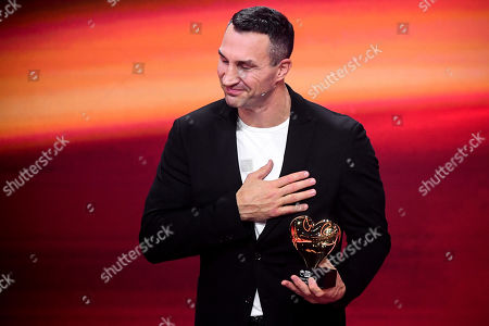 epa08865411 Former Ukrainian boxing heavyweight champion Wladimir Klitschko reacts as he is honored with the golden heart for his extraordinary commitment to children during the 'Ein Herz Fuer Kinder' (lit: A Heart for Children) gala show in Berlin, Germany, 05 December 2020. German television channel ZDF and newspaper 'Bild' collected donations for children's charity organizations in Germany and the whole world. EPA-EFE/CLEMENS BILAN / POOL