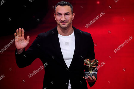 epa08865410 Former Ukrainian boxing heavyweight champion Wladimir Klitschko reacts as he is honored with the golden heart for his extraordinary commitment to children during the 'Ein Herz Fuer Kinder' (lit: A Heart for Children) gala show in Berlin, Germany, 05 December 2020. German television channel ZDF and newspaper 'Bild' collected donations for children's charity organizations in Germany and the whole world. EPA-EFE/CLEMENS BILAN / POOL