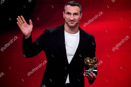 epa08865412 Former Ukrainian boxing heavyweight champion Wladimir Klitschko reacts as he is honored with the golden heart for his extraordinary commitment to children during the 'Ein Herz Fuer Kinder' (lit: A Heart for Children) gala show in Berlin, Germany, 05 December 2020. German television channel ZDF and newspaper 'Bild' collected donations for children's charity organizations in Germany and the whole world. EPA-EFE/CLEMENS BILAN / POOL