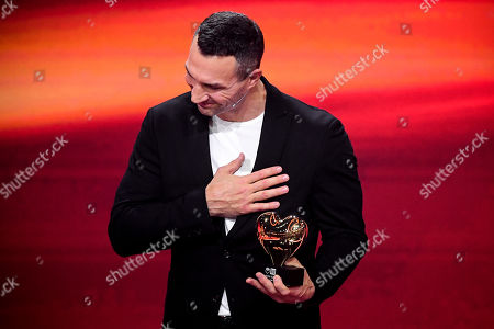 epa08865413 Former Ukrainian boxing heavyweight champion Wladimir Klitschko reacts as he is honored with the golden heart for his extraordinary commitment to children during the 'Ein Herz Fuer Kinder' (lit: A Heart for Children) gala show in Berlin, Germany, 05 December 2020. German television channel ZDF and newspaper 'Bild' collected donations for children's charity organizations in Germany and the whole world. EPA-EFE/CLEMENS BILAN / POOL