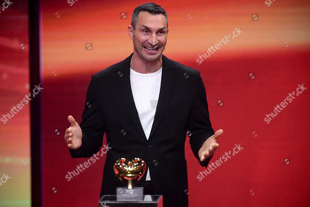 epa08865414 Former Ukrainian boxing heavyweight champion Wladimir Klitschko reacts as he is honored with the golden heart for his extraordinary commitment to children during the 'Ein Herz Fuer Kinder' (lit: A Heart for Children) gala show in Berlin, Germany, 05 December 2020. German television channel ZDF and newspaper 'Bild' collected donations for children's charity organizations in Germany and the whole world. EPA-EFE/CLEMENS BILAN / POOL