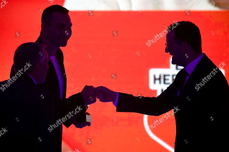 Stock Photo of epa08865415 German Health Minister Jens Spahn (R) and former Ukrainian boxing heavyweight champion Wladimir Klitschko (L) fist bump during the 'Ein Herz Fuer Kinder' (lit: A Heart for Children) gala show in Berlin, Germany, 05 December 2020. German television channel ZDF and newspaper 'Bild' collected donations for children's charity organizations in Germany and the whole world. EPA-EFE/CLEMENS BILAN / POOL