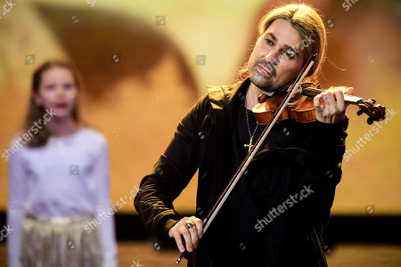 Stock Picture of epa08865099 German violinist David Garrett performs on stage during the 'Ein Herz Fuer Kinder' (lit: A Heart for Children) gala show in Berlin, Germany, 05 December 2020. German television channel ZDF and newspaper 'Bild' collected donations for children's charity organizations in Germany and the whole world. EPA-EFE/CLEMENS BILAN / POOL