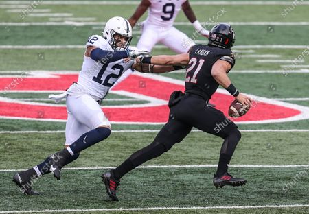 Penn State Nittany Lions linebacker Brandon Smith (12) tries to tackle Rutgers quarterback Johnny Langan (21) during an NCAA football game between the Penn State Nittany Lions and the Rutgers Scarlet Knights at SHI Stadium in Piscataway, NJ. Penn State beat Rutgers 23-7