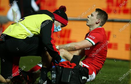 Liam Williams of Wales is treated after picking up an injury forcing him off the pitch
