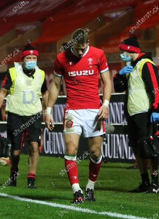 Liam Williams of Wales leaves the pitch after picking up an injury