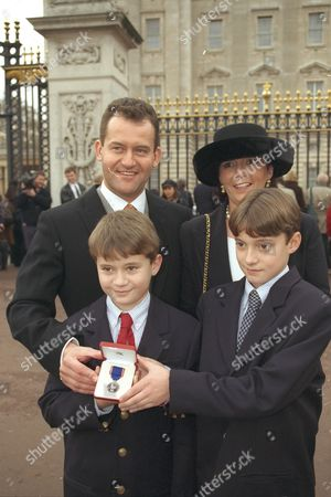 Paul Burrell Diana Princess Of Wales's Former Butler At Buckingham Palace Where He Received The Royal Victorian Medal For His Work In The Household Of The Late Diana His Family Wife Maria Sons Nicky And Alexander Share The Proud Moment.