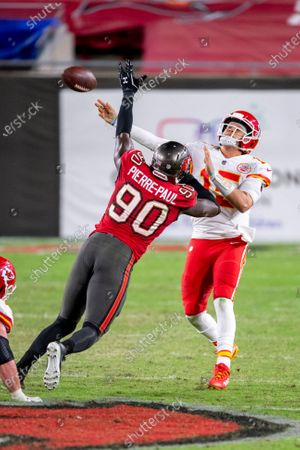 Stock Picture of Kansas City Chiefs quarterback Patrick Mahomes (15) throws the ball under pressure from Tampa Bay Buccaneers linebacker Jason Pierre-Paul (90) during an NFL football game, in Tampa, Fla