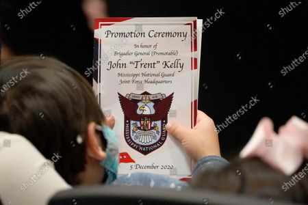 """Logan Cockrell, 4, nephew of Rep. John """"Trent"""" Kelly, R-Miss., holds a program outlining his promotion ceremony to major general in the Mississippi Army National Guard, in Jackson, Miss. The congressman will also assume the position of Assistant Adjutant General in the Mississippi Army National Guard with his promotion"""