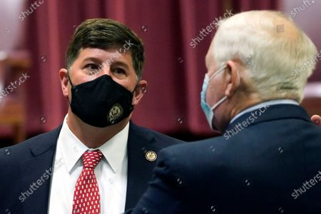 """Rep. Steven Palazzo, R-Miss., confers with a fellow attendee following the promotion ceremony of Rep. John """"Trent"""" Kelly, R-Miss., to major general in the Mississippi Army National Guard, in Jackson, Miss. The congressman will also assume the position of Assistant Adjutant General with his promotion"""