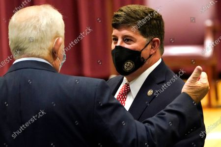 """Rep. Steven Palazzo, R-Miss., confers with a fellow attendee following the promotion ceremony of Rep. John """"Trent"""" Kelly, R-Miss., to major general in the Mississippi Army National Guard, in Jackson, Miss"""